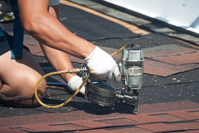 Amish roofer installing roofing shingles
